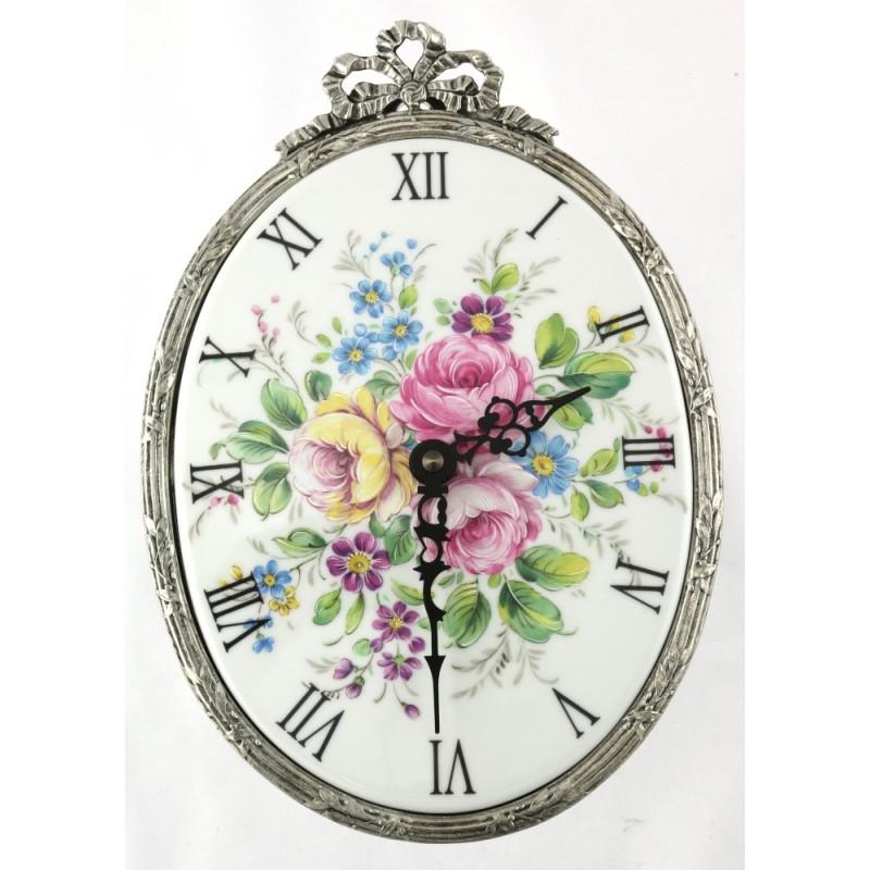 Horloge ovale décor T