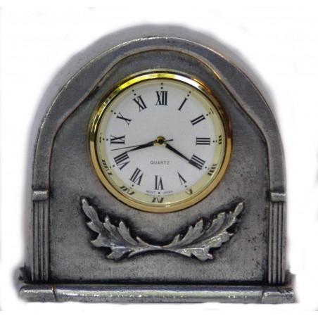 Horloge miniature en étain
