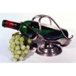 Porte bouteille avec pied et décor raisin en étain